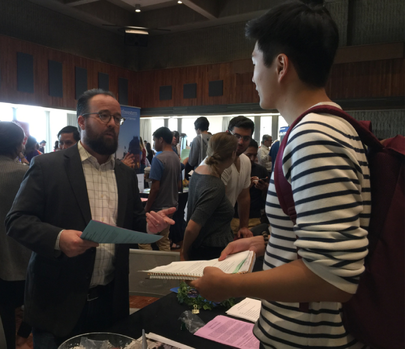 Professor Platte, Director of Undergraduate Studies, speaks to student at the Weinberg Academic Directions Fair